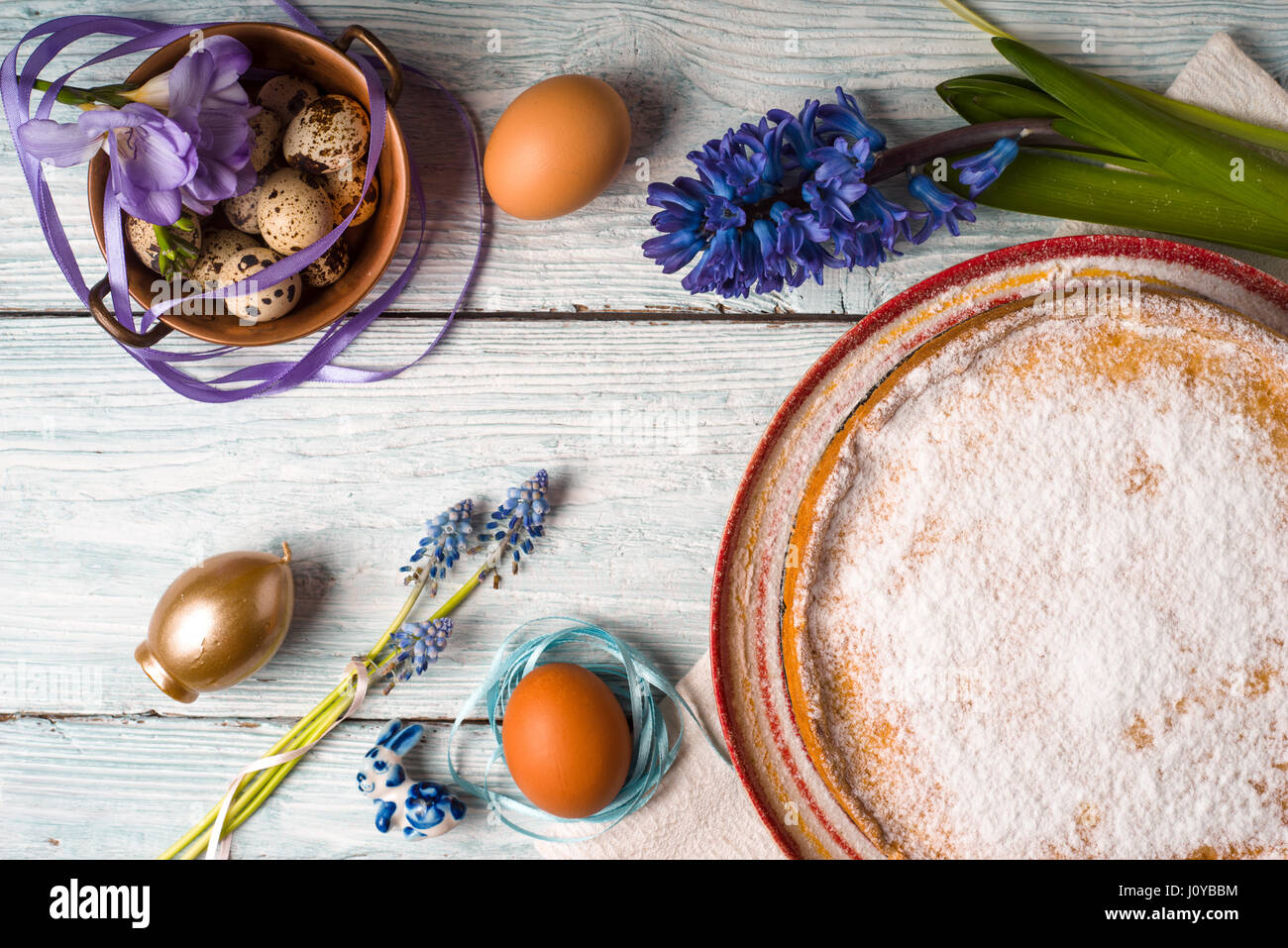 German Easter cake with decoration and flower on the white wooden table top view - Stock Image