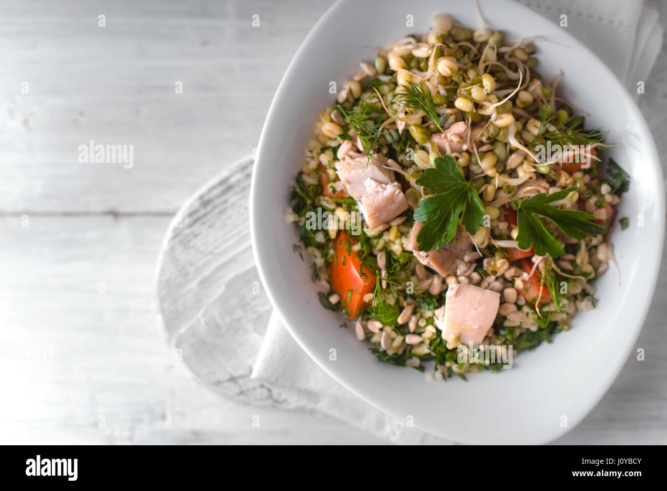 Healthy salad on the white wooden table top view - Stock Image