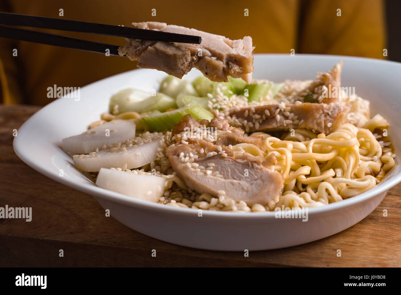 Noodles with chicken and vegetable  on the wooden board - Stock Image