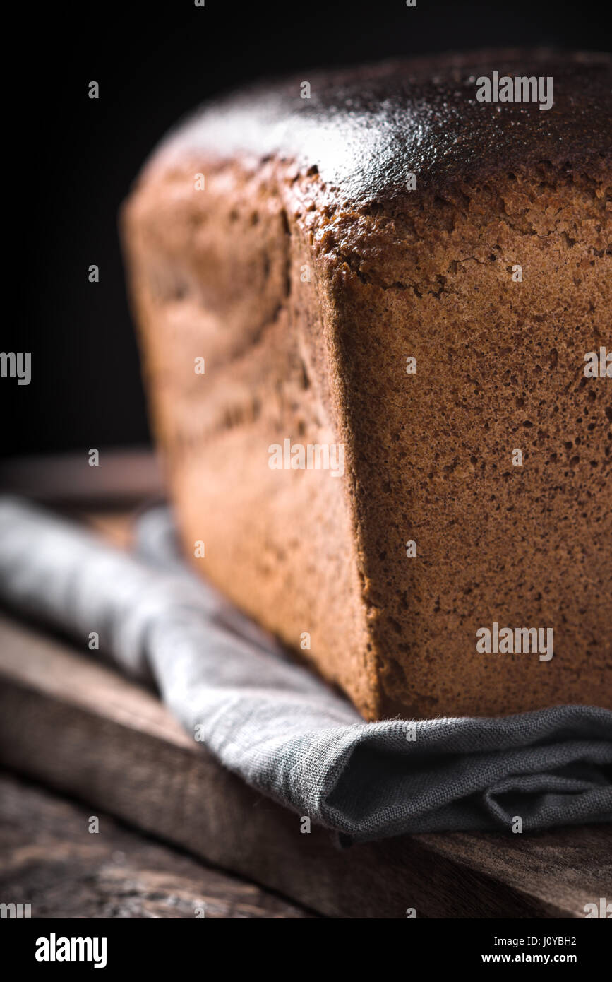 Rye bread on the wooden board vertical - Stock Image