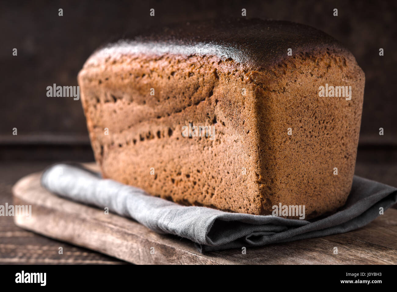 Rye bread on the wooden board horizontal - Stock Image