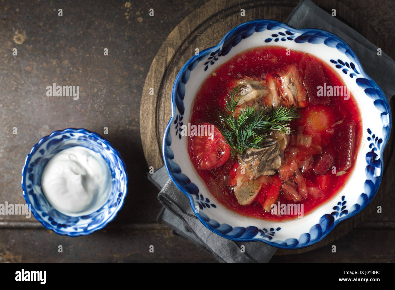 Traditional Russian dishes on the wooden table top view - Stock Image