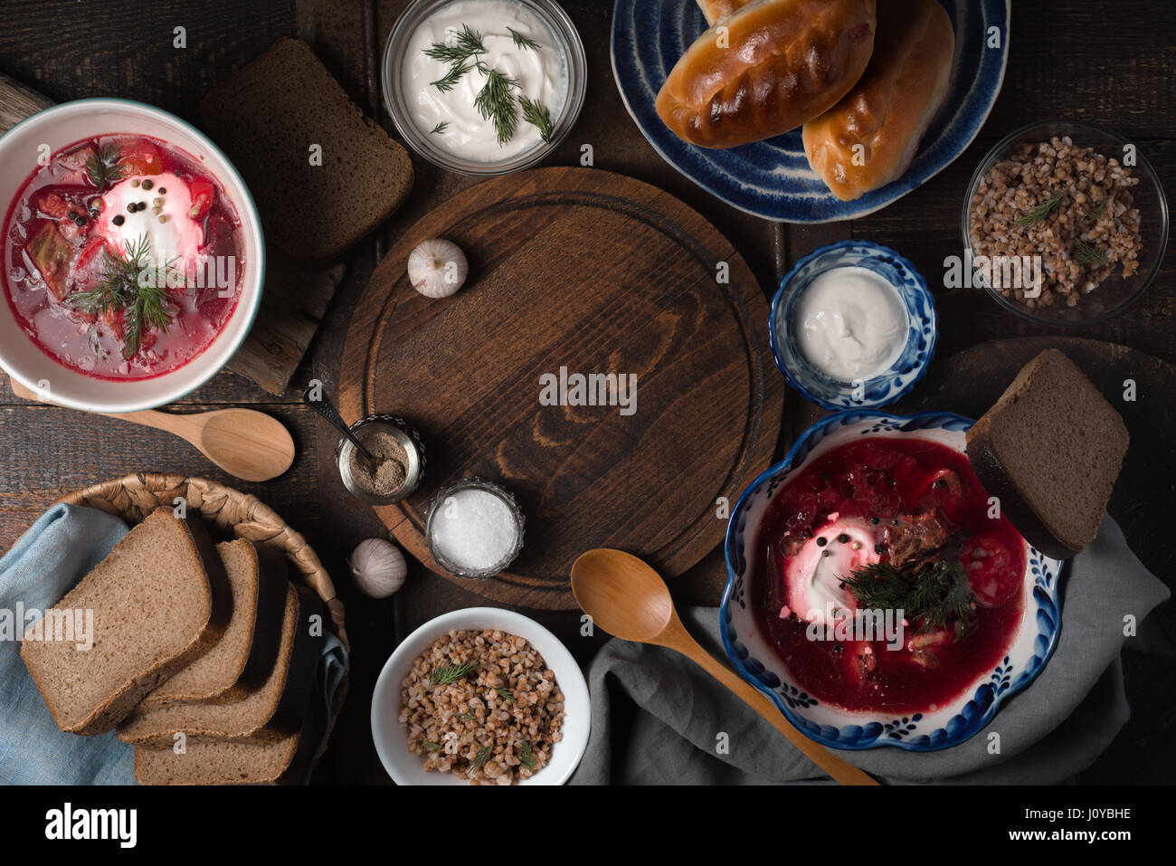 Dishes of traditional Russian cuisine on the wooden table top view - Stock Image