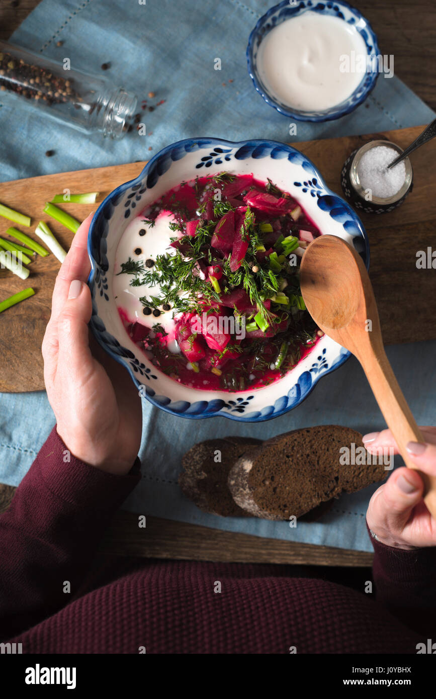 Woman eating traditional beetroot soup borsch top view - Stock Image