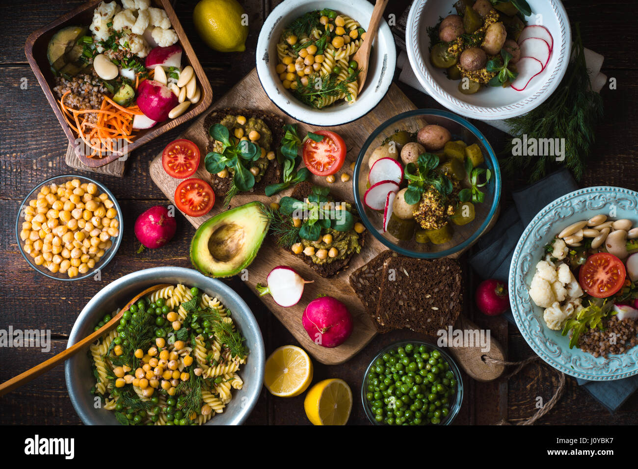 Different salad and snack on the wooden table top view - Stock Image