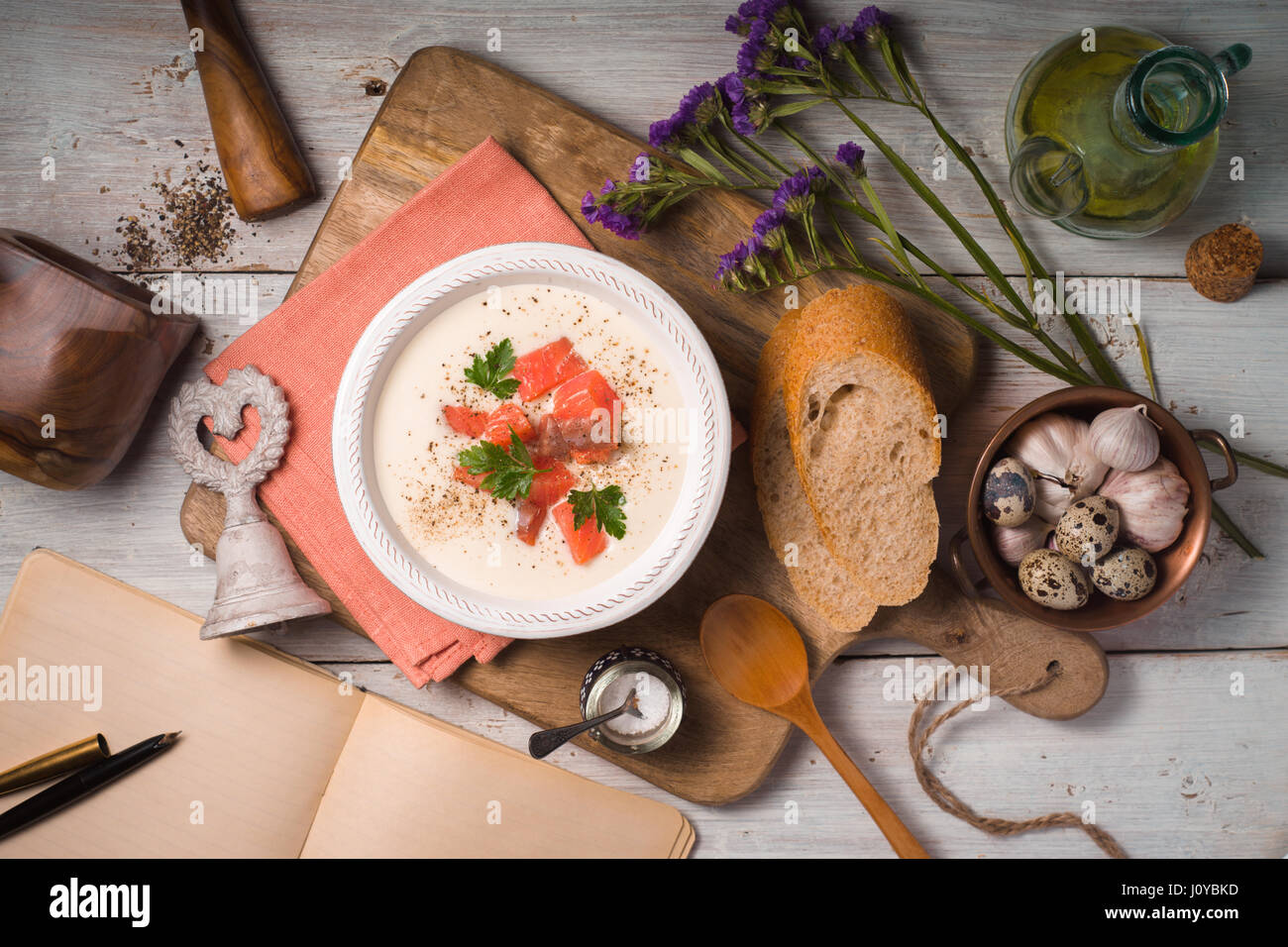 Soup puree from cauliflower and salmon top view - Stock Image