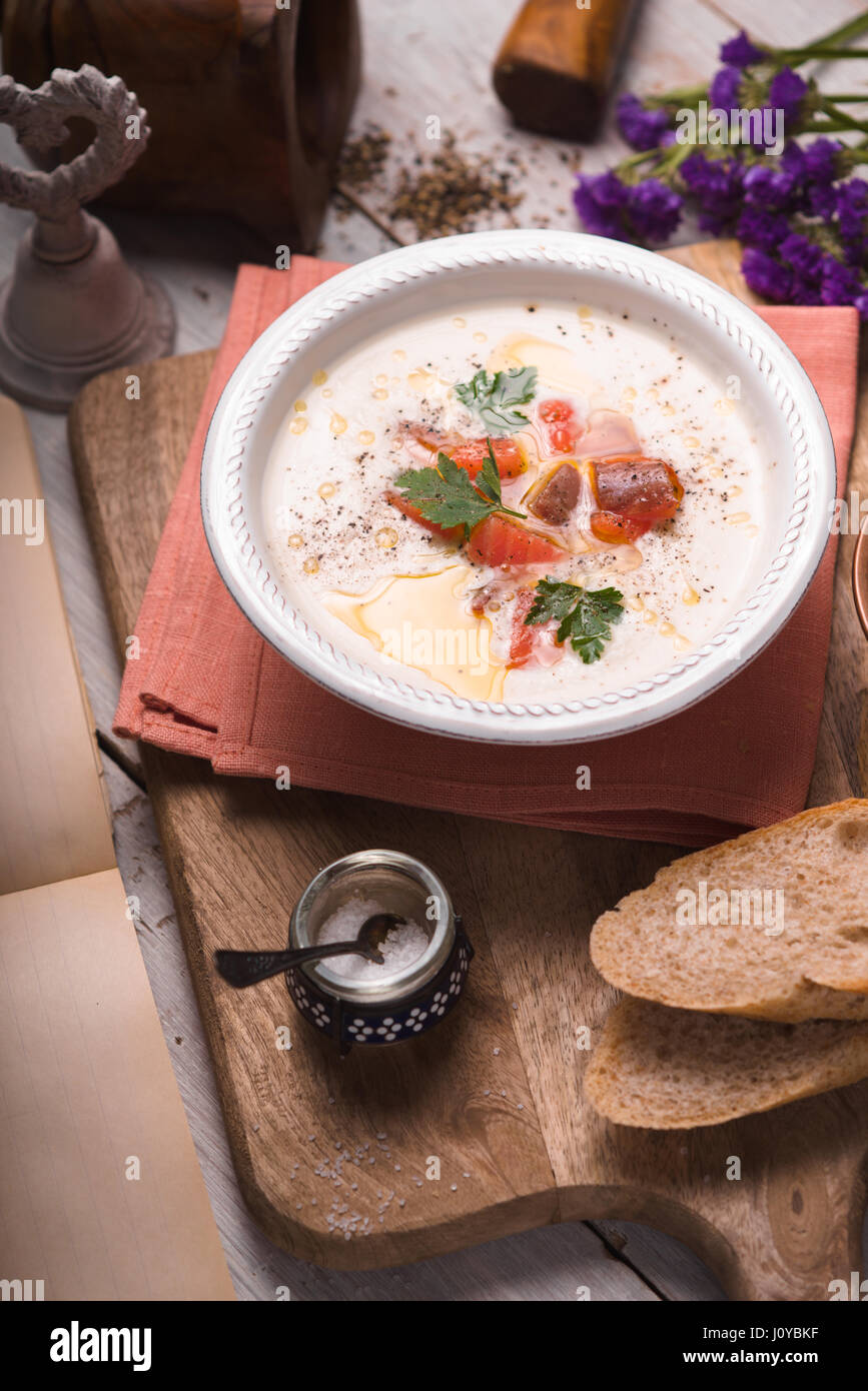 Soup puree with salmon in a ceramic bowl - Stock Image