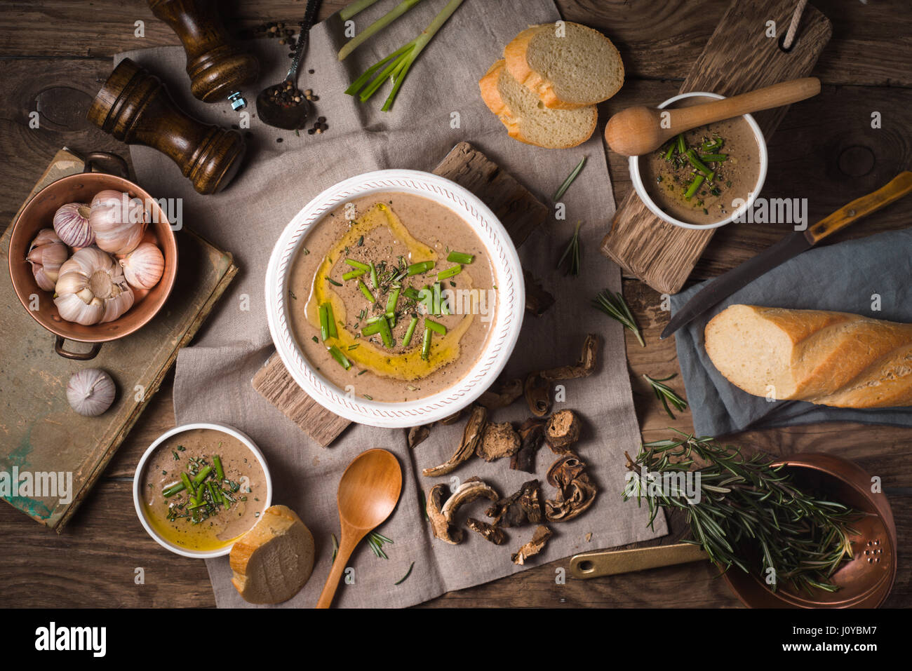 Mushroom soup puree in ceramic bowls three servings - Stock Image