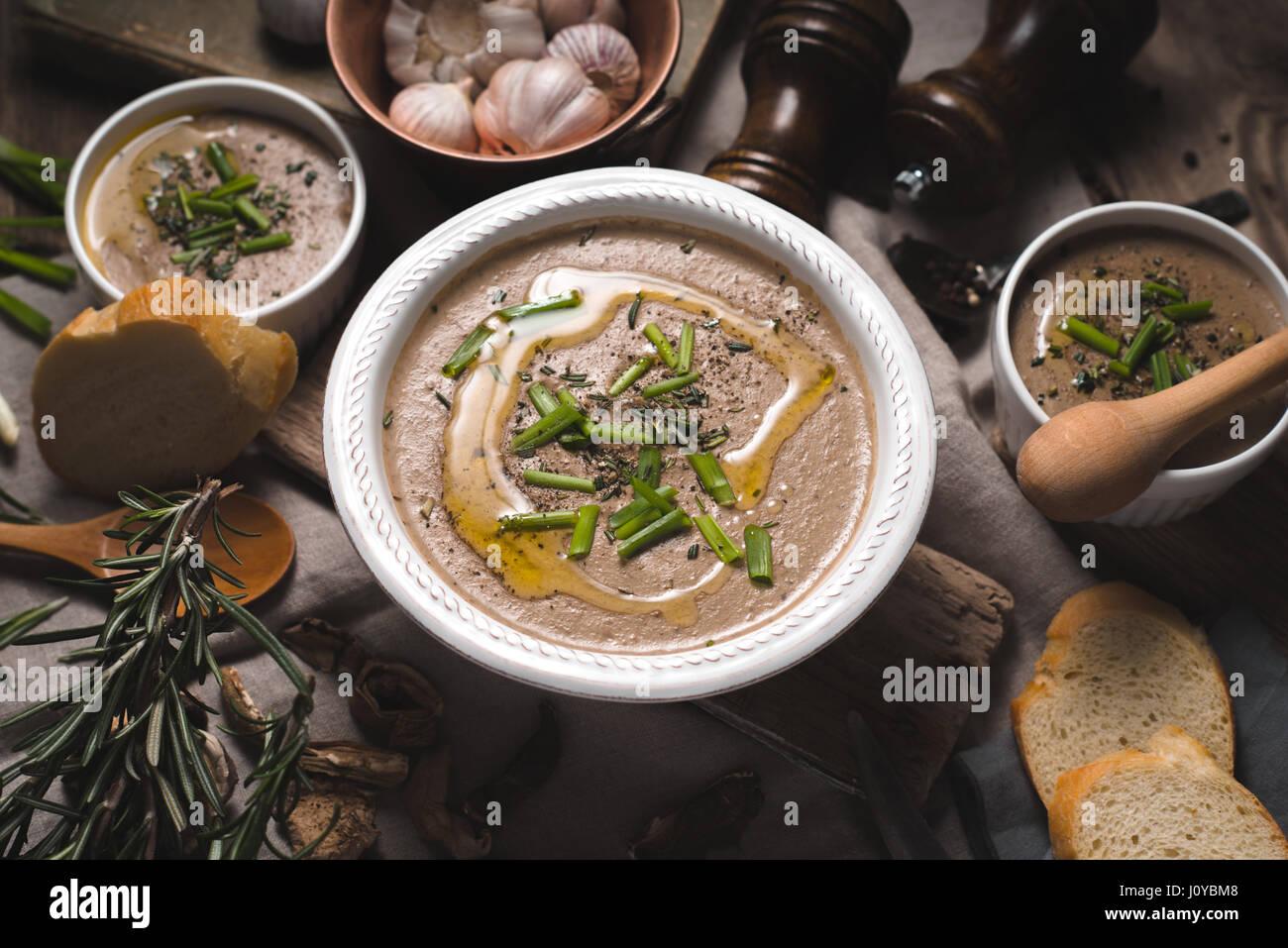 Mushroom soup puree in ceramic bowls top view - Stock Image