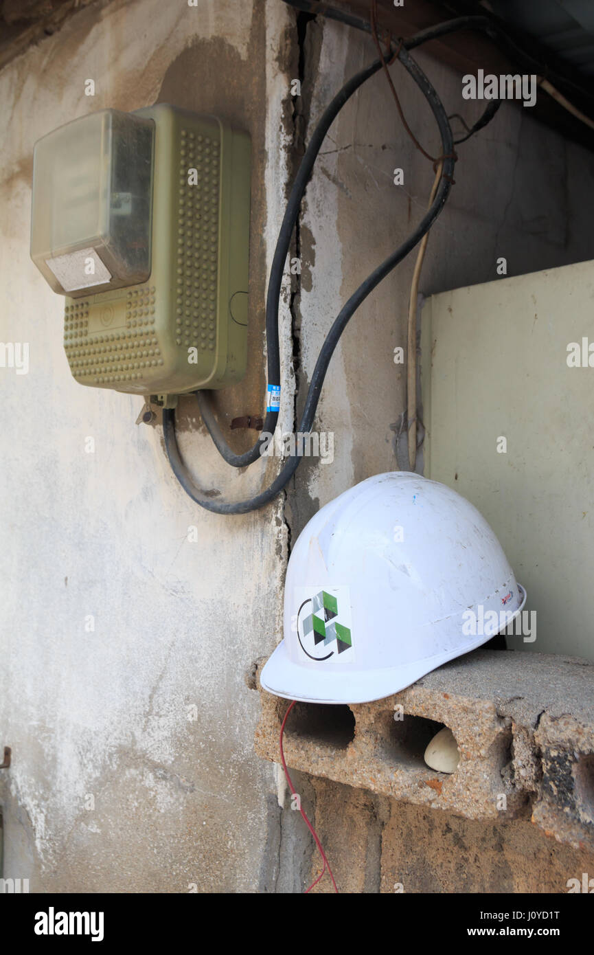 old voltameter box and safety halmet - Stock Image