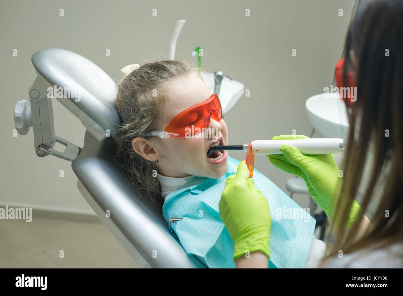 small girl patient at the dentist - Stock Image
