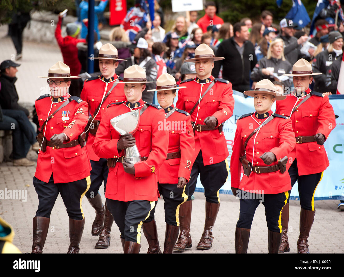 Royal Canadian Mounted Police, or RCMP officers in traditional dress red serge uniforms parade during the Canada - Stock Image
