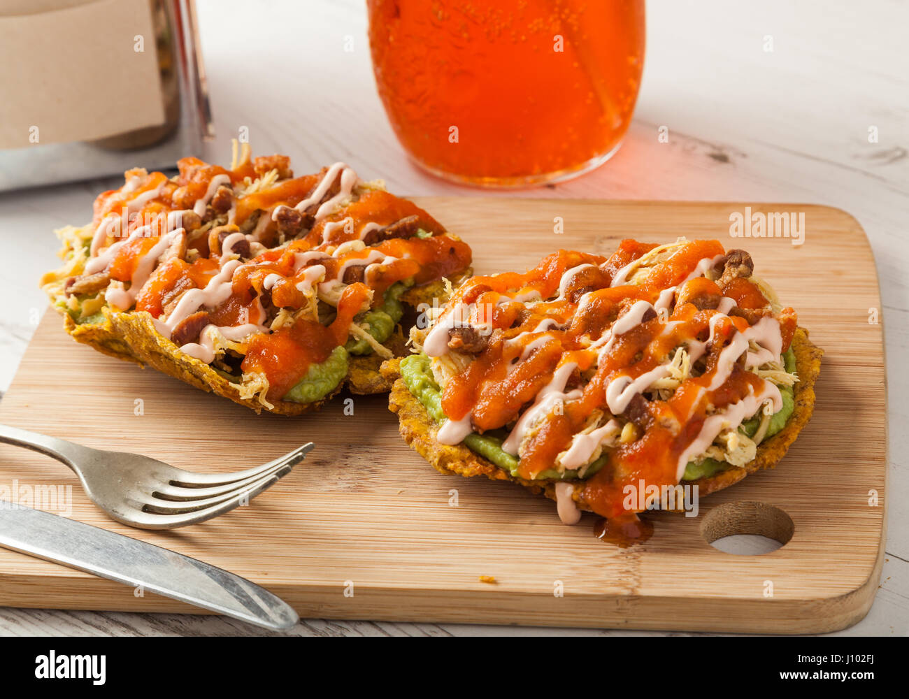 Colombian Food Patacones With Guacamole And Meat Stock Photo