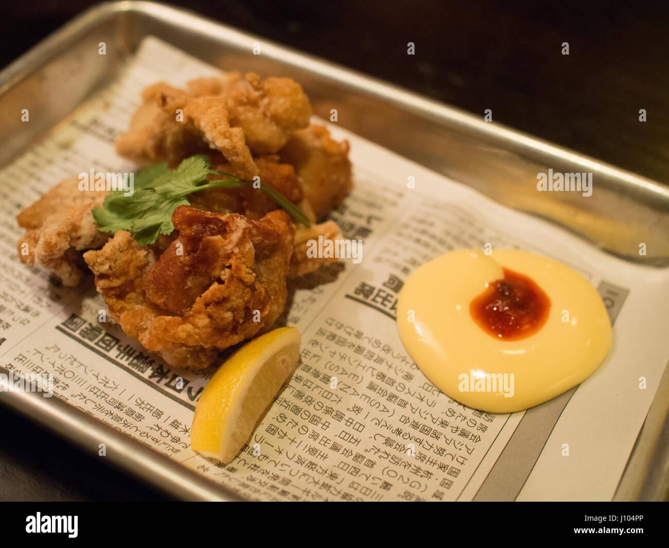 Chicken kaarage at Kemuri Tatsu-ya, a Japanese izakaya in Austin, Texas - Stock Image