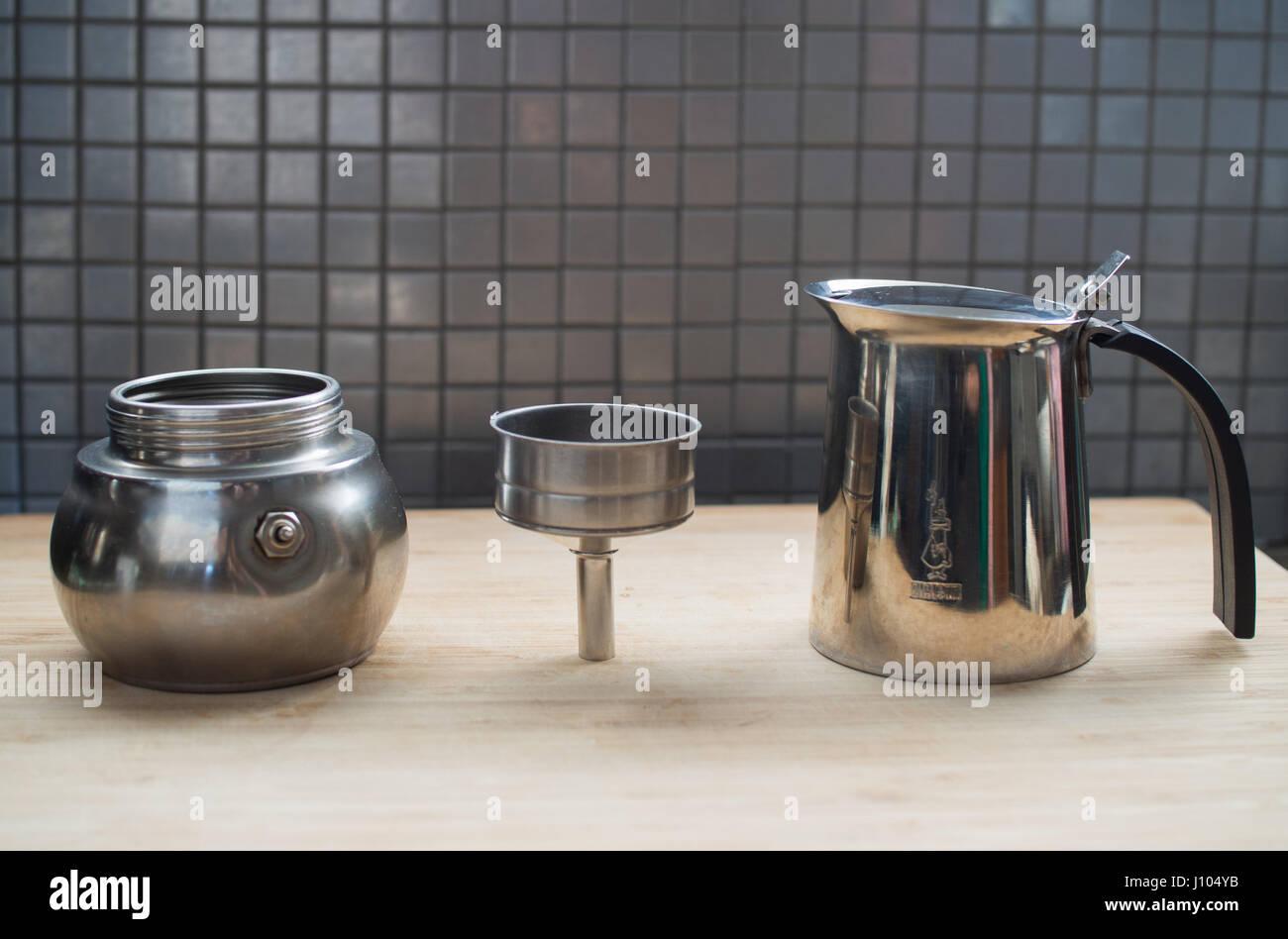 Using a moka pot to make espresso on a stove - Stock Image