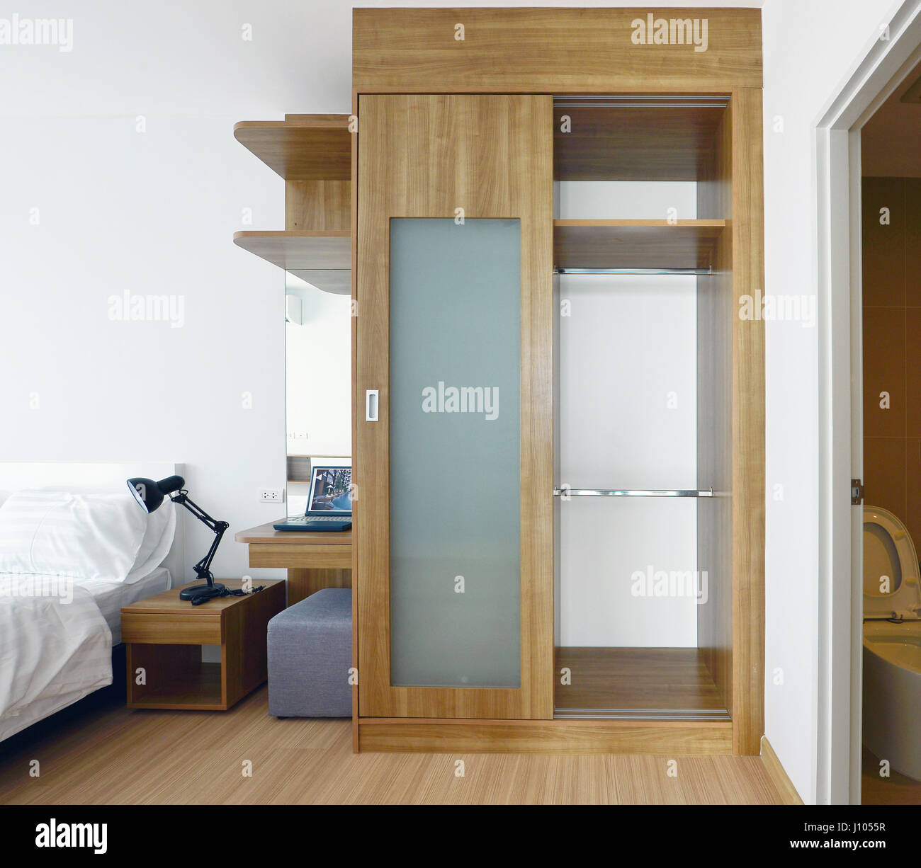 Wooden Carbinets In Luxury Modern Bedroom Interior And