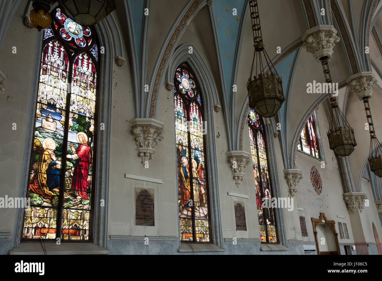 Gothic German Catholic Church Interior With Stained Glass Windows And Ornate Light Fixtures