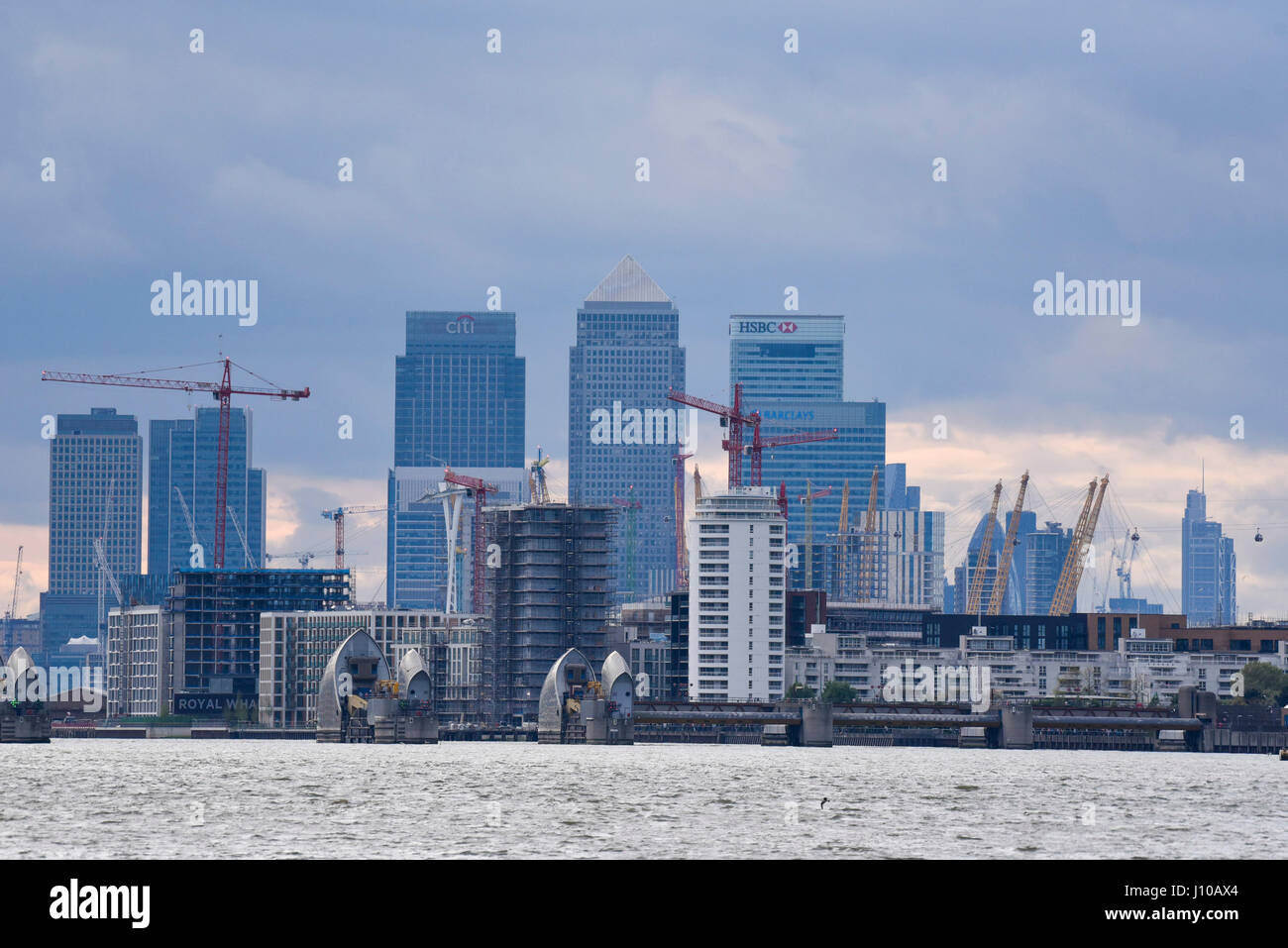 London, UK. 16th Apr, 2017. The distant skyscrapers of Canary Wharf are seen, home to the headquarters of many financial - Stock Image