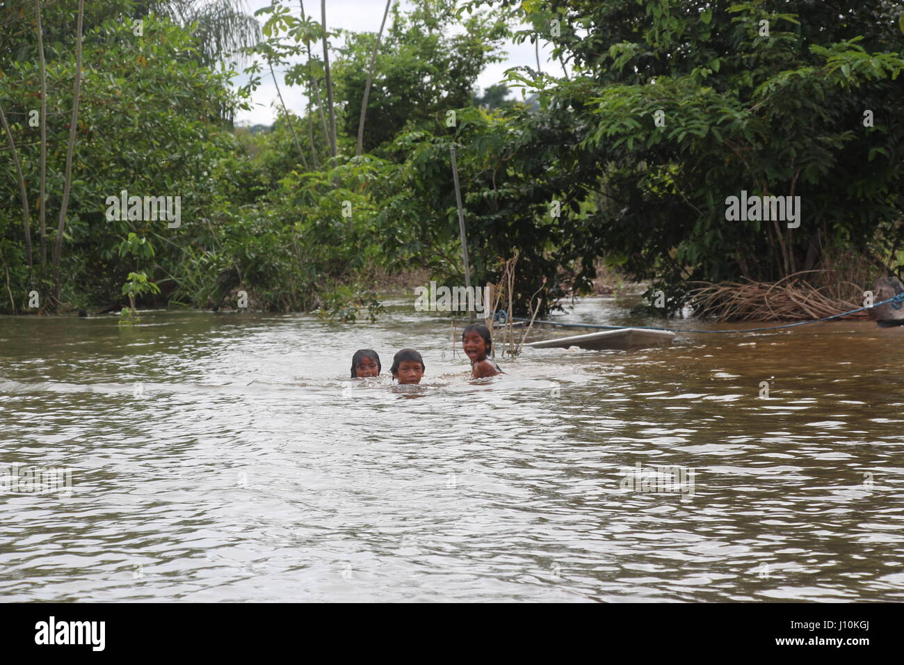 Local children take a swim in Juruena National Park in Brazil, 23 March 2017. The Amazonian park is one of the world's - Stock Image