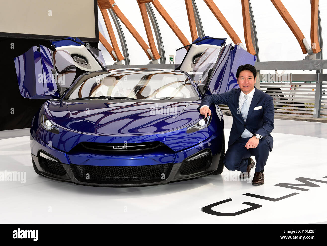 President Hiroyasu Koma of Green Lord Motors introduces its luxury sedan GLM G4, Japan's first mass-production electric vehicle, to the media in Tokyo on ...