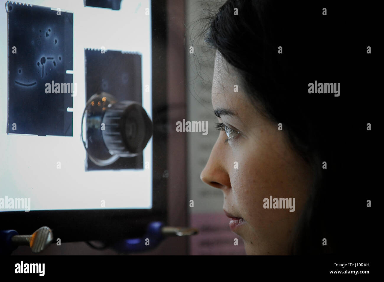 London, UK.  18 April 2017.  A visitor views an exhibit of influenza virus negative stain images captured using - Stock Image