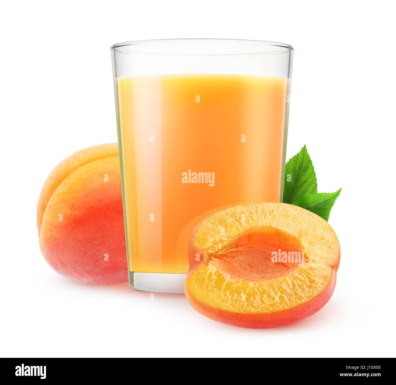 Isolated juice. Glass of apricot smoothie and cut fruits isolated on white background with clipping path - Stock Image