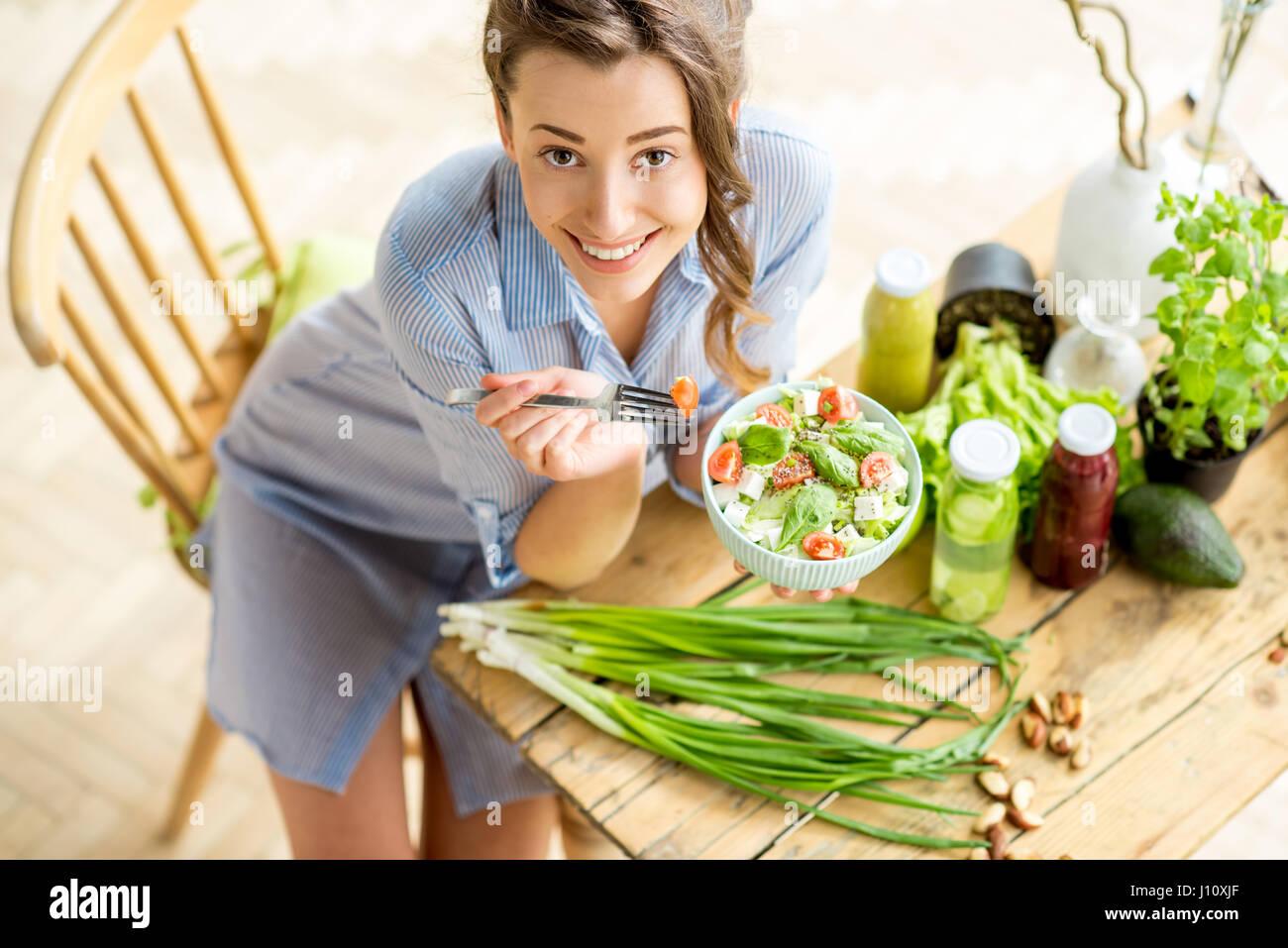Woman eating healthy salad - Stock Image