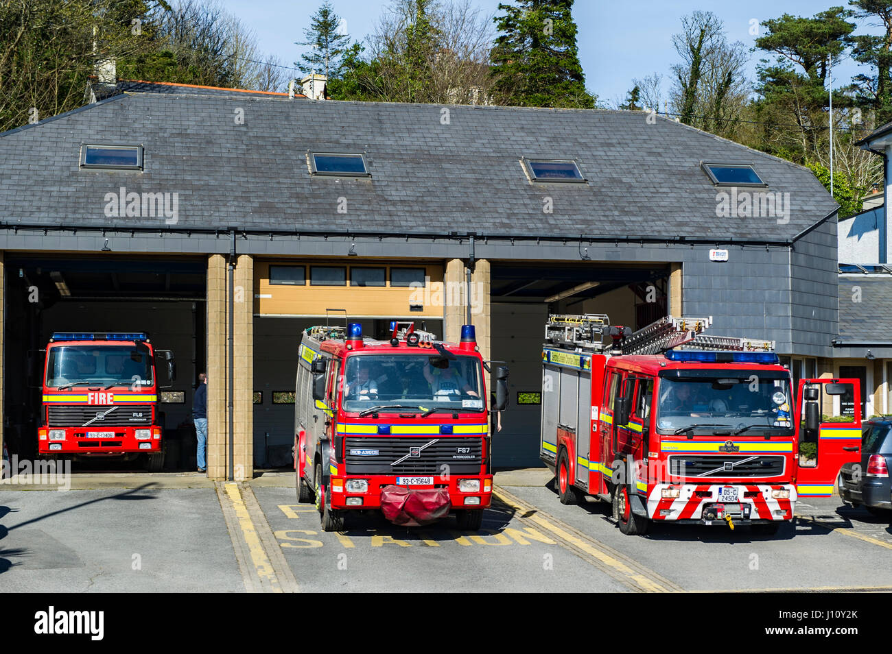 Fire engines stand outside Bantry Fire Station just after the alarm has sounded for firefighters to attend a fire - Stock Image