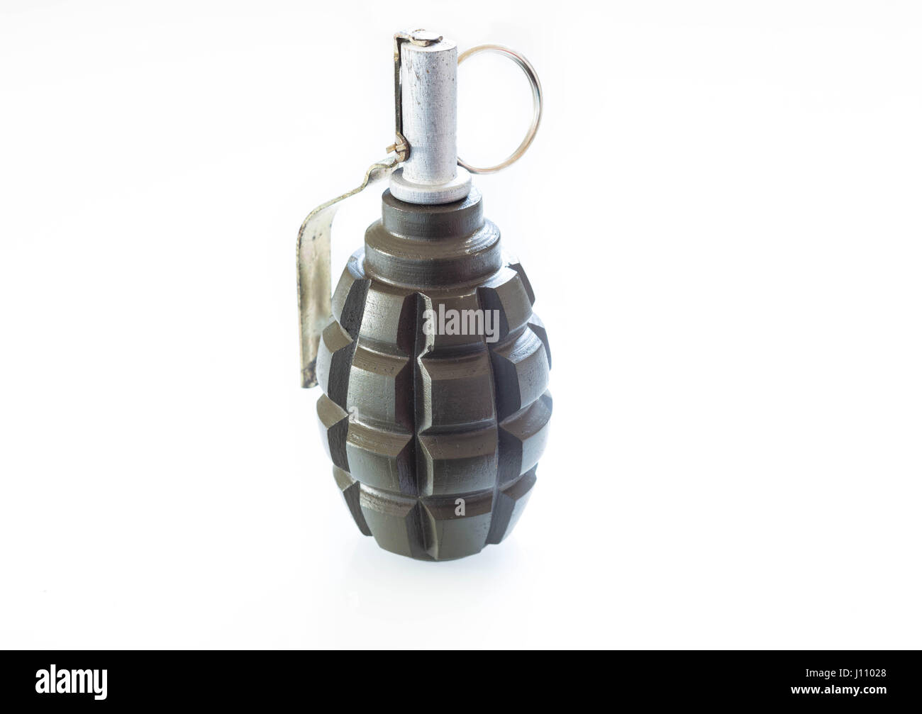Hand grenade on a white background - Stock Image