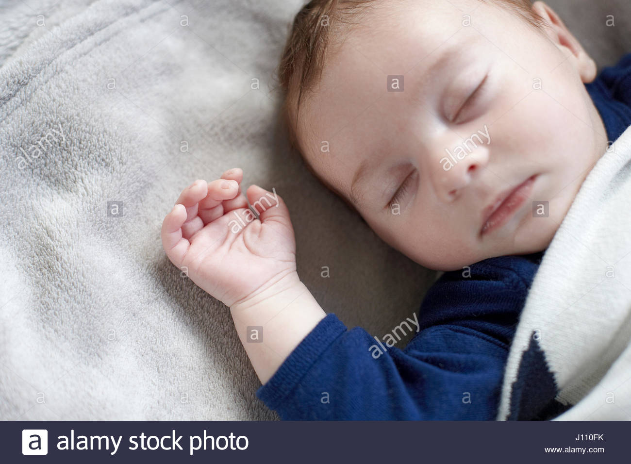 2 Month old new born Baby Boy lying on his back shot overhead - Stock Image