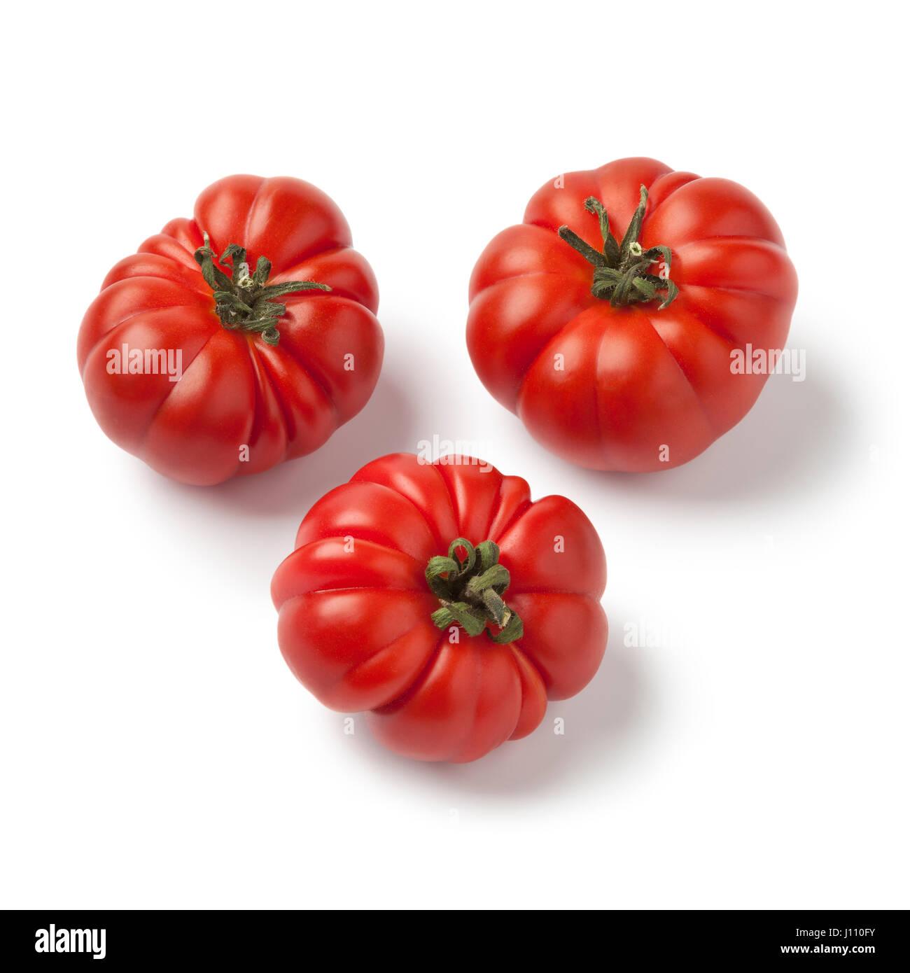 Fresh red ripe merinda tomatoes on white background - Stock Image