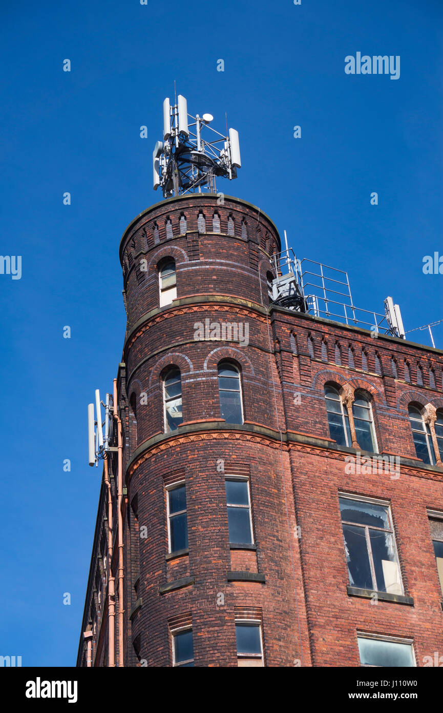 Mobile Phone masts on an old mill building - Stock Image