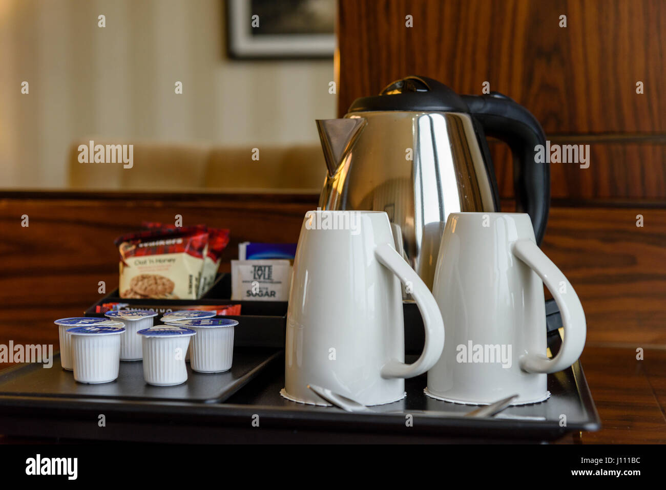 Tea and coffee making facilities in a hotel room. - Stock Image