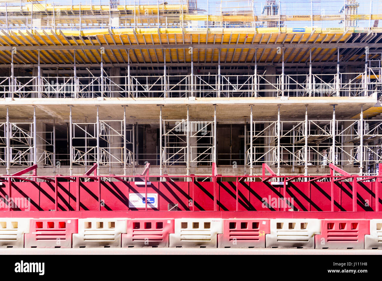 Scaffold and barriers at a building site. - Stock Image