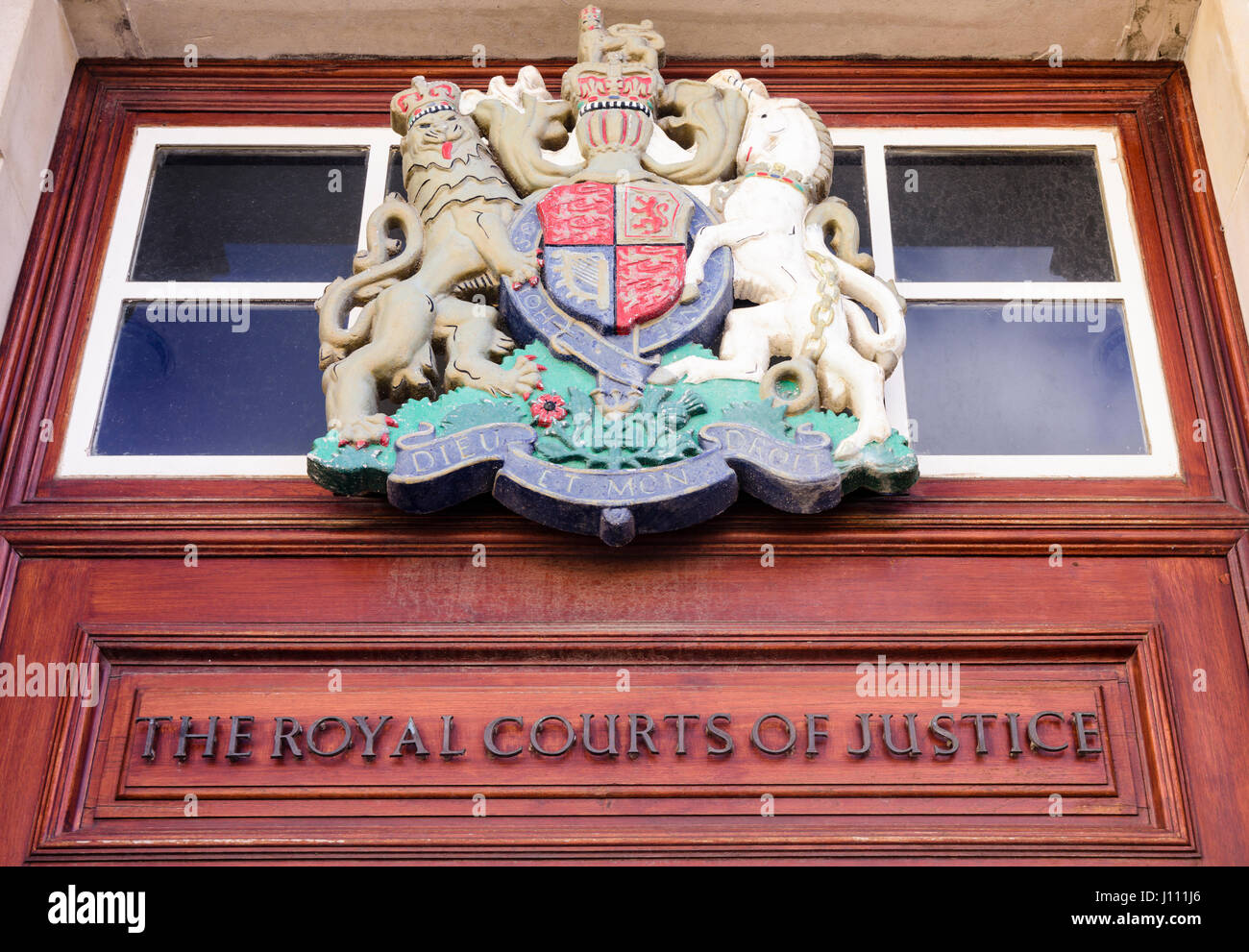 Royal coat of arms above the door of the Royal Courts of Justice, Belfast. - Stock Image