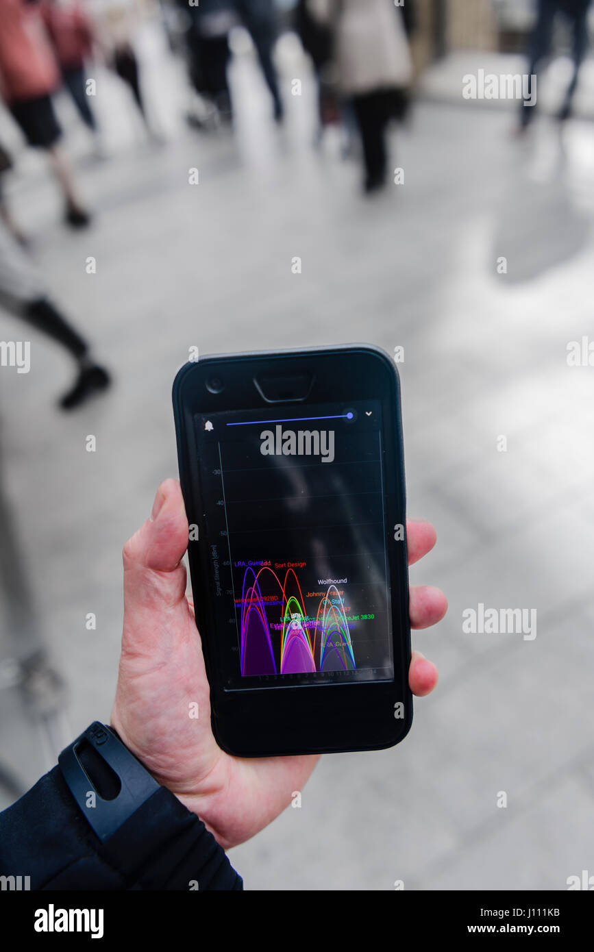 A Smartphone showing cluttered wifi signals in a public place. - Stock Image
