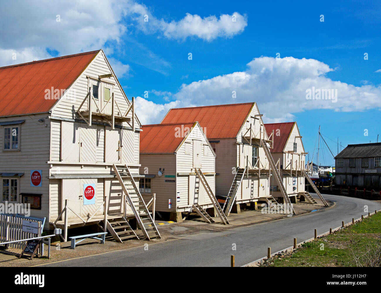 Sail lofts on stilts, Tollesbury, Essex, England UK - Stock Image