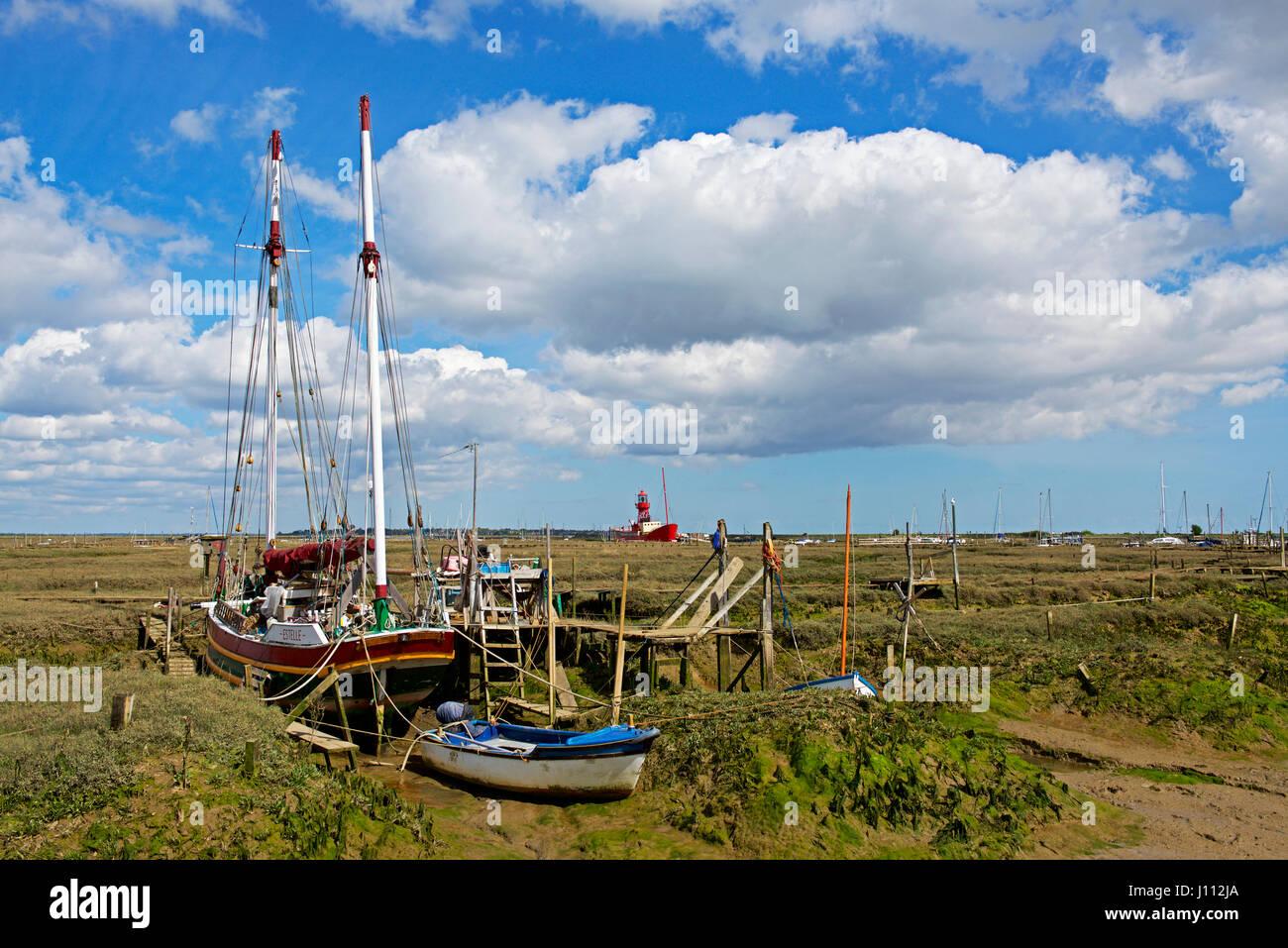 Boats on the saltmarsh, Tollesbury, Essex, England UK Stock Photo
