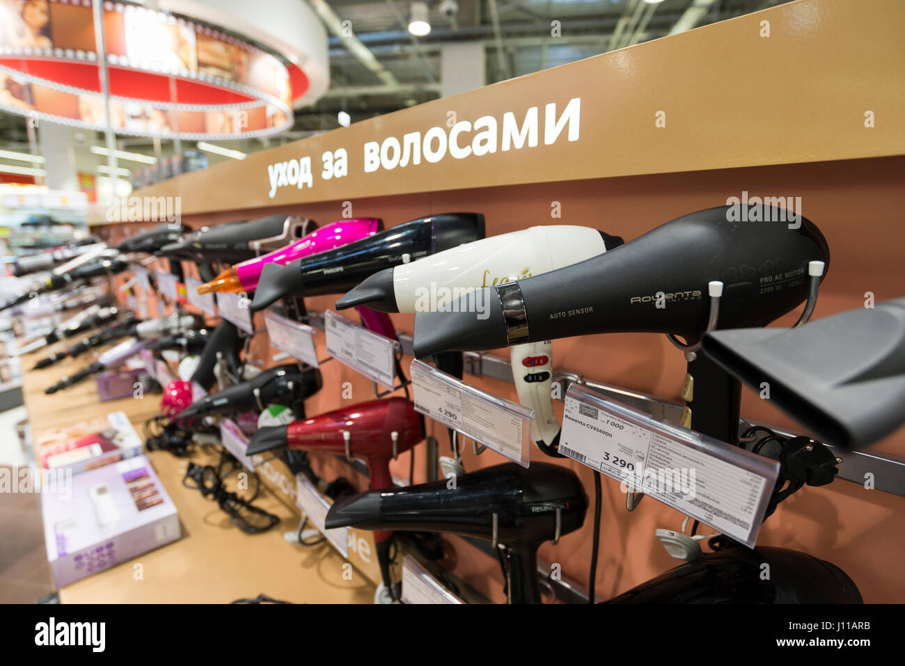 Khimki, Russia - December 22 2015. Hair dryers in Mvideo large chain stores selling electronics and household appliances - Stock Image