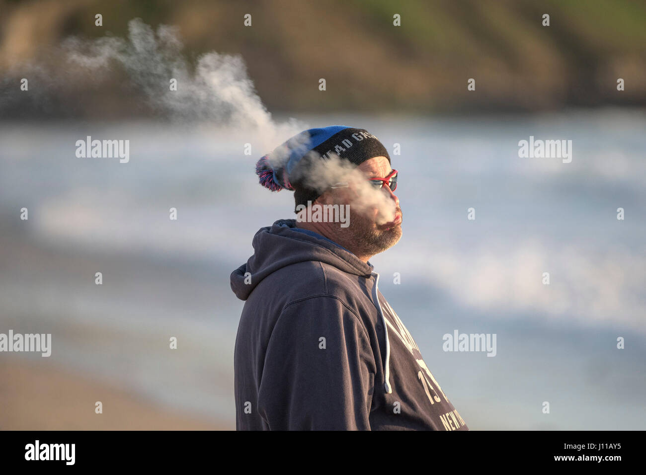 Man Vaping Vaper Exhaling Individual Alone - Stock Image