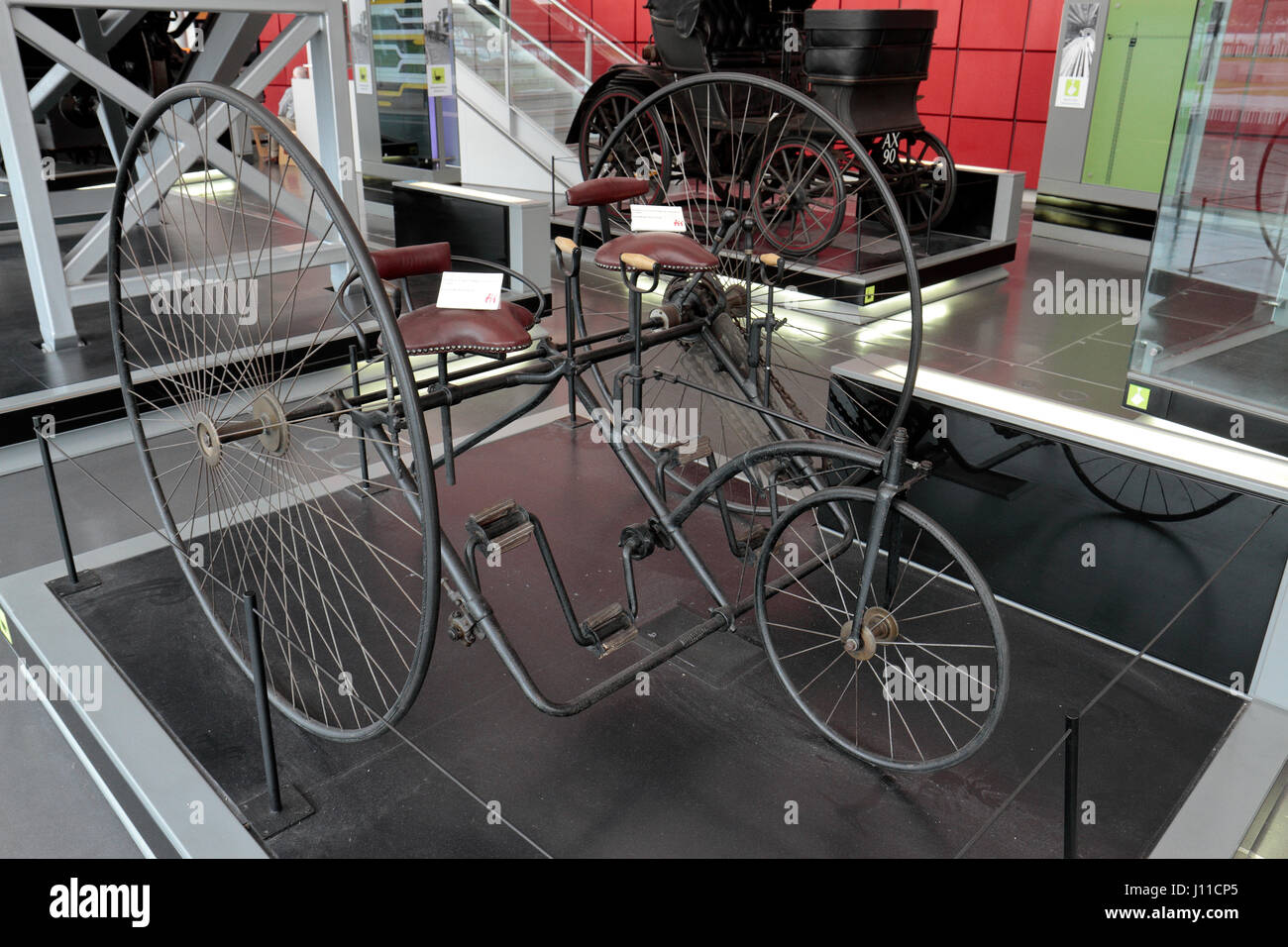 A Sociable tricycle on display in the National Waterfront Museum, Swansea, Wales. - Stock Image