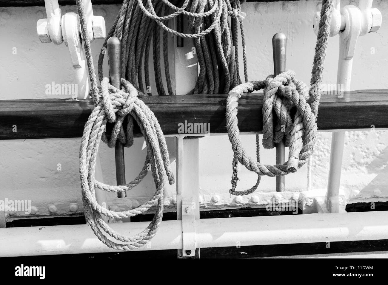 Rolled Ropes Tied Up On Ship Railing - Stock Image