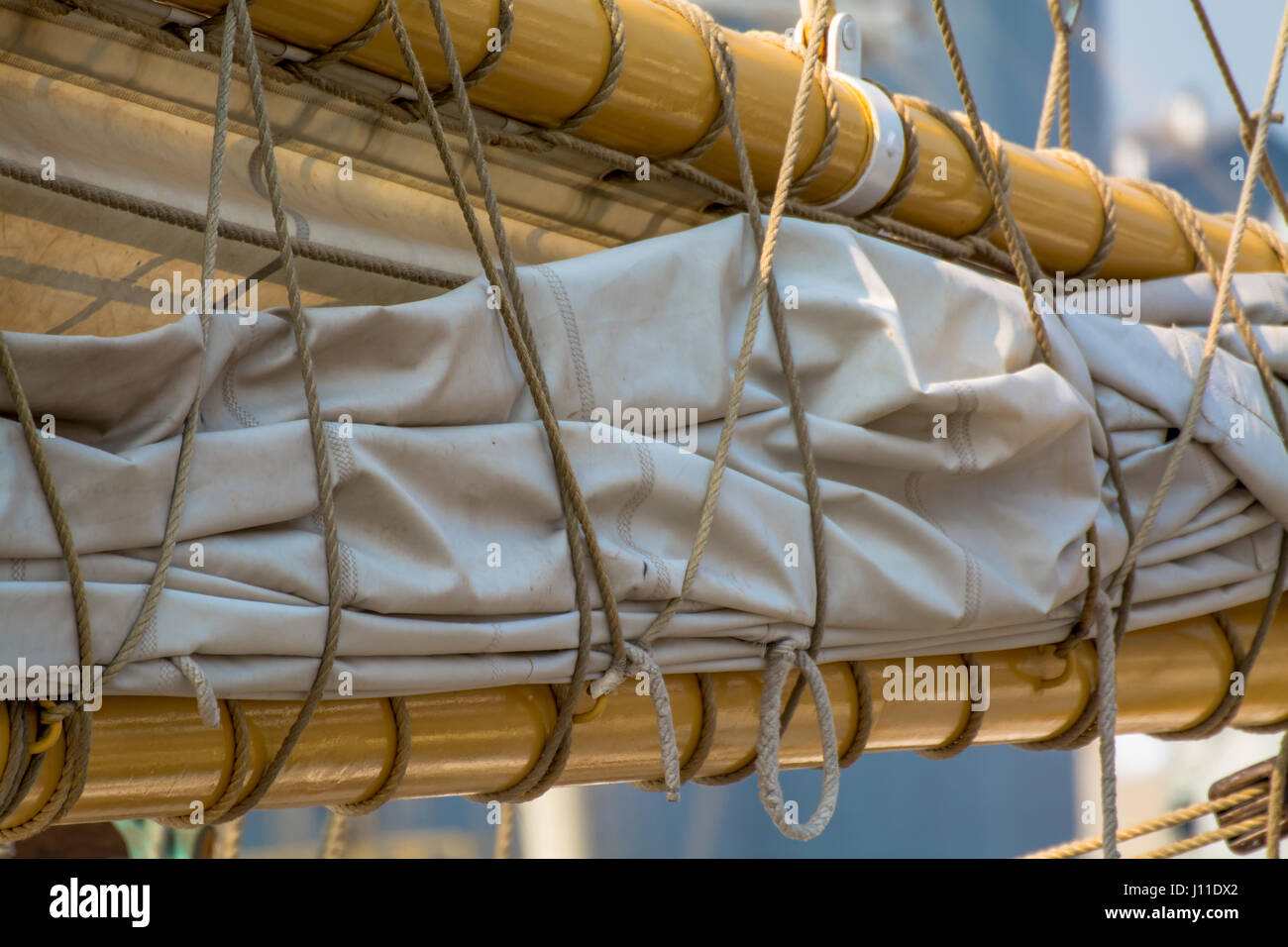 Side View of Ship Sails Tied Up - Stock Image