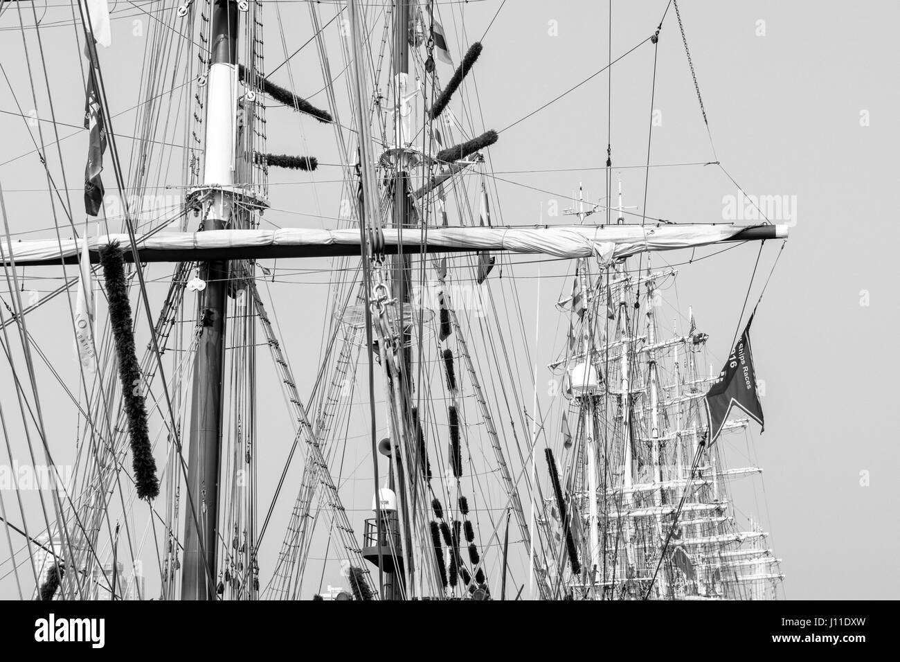 Low Angle View of Tall Ships Masts Against Clear Sky - Stock Image