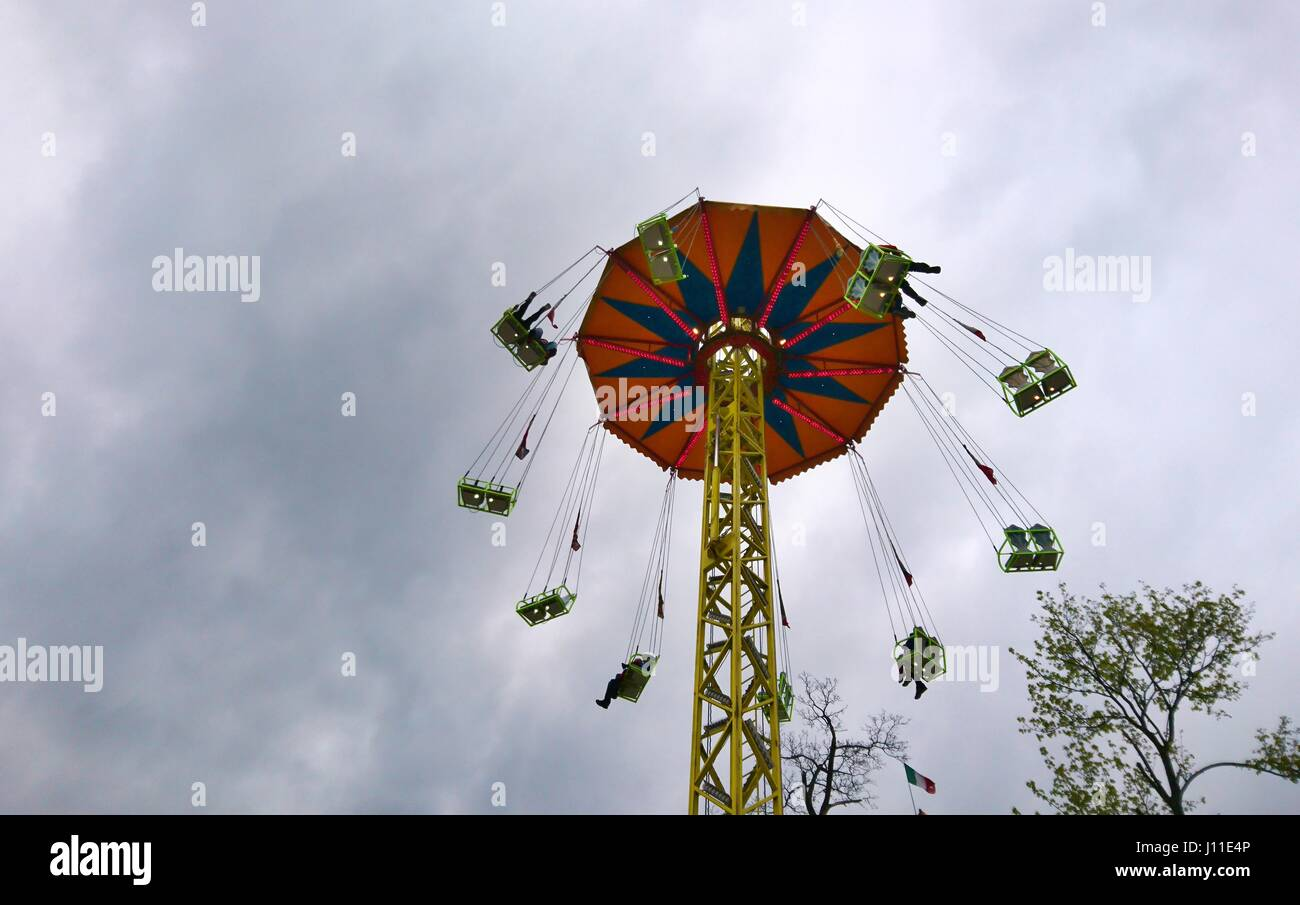 Looking Up on Swinging Chair Swing Ride. - Stock Image
