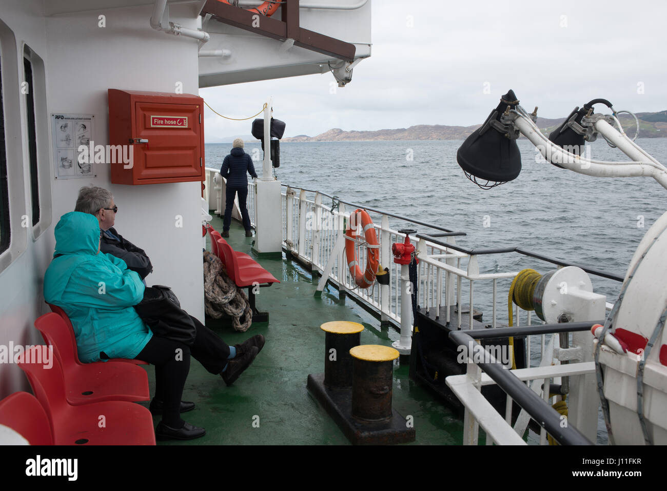 Passengers on board the Cal Mac Ferry Lochnevis bound for Canna Island, Inner Hebrides Scotland - Stock Image
