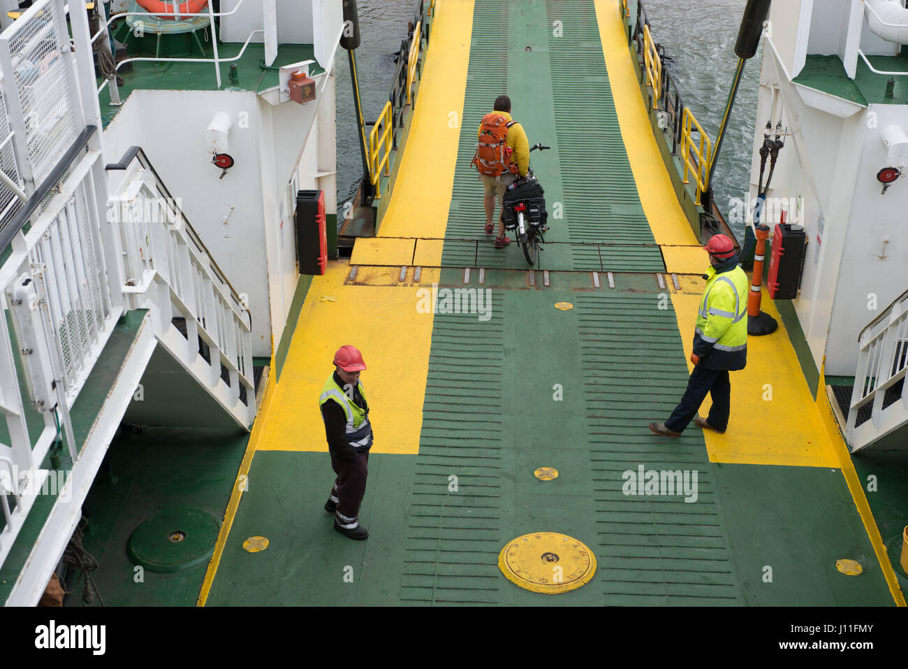 Passengers on board the Cal Mac Ferry Lochnevis landing on the island of Rum Inner Hebrides,  Scotland - Stock Image