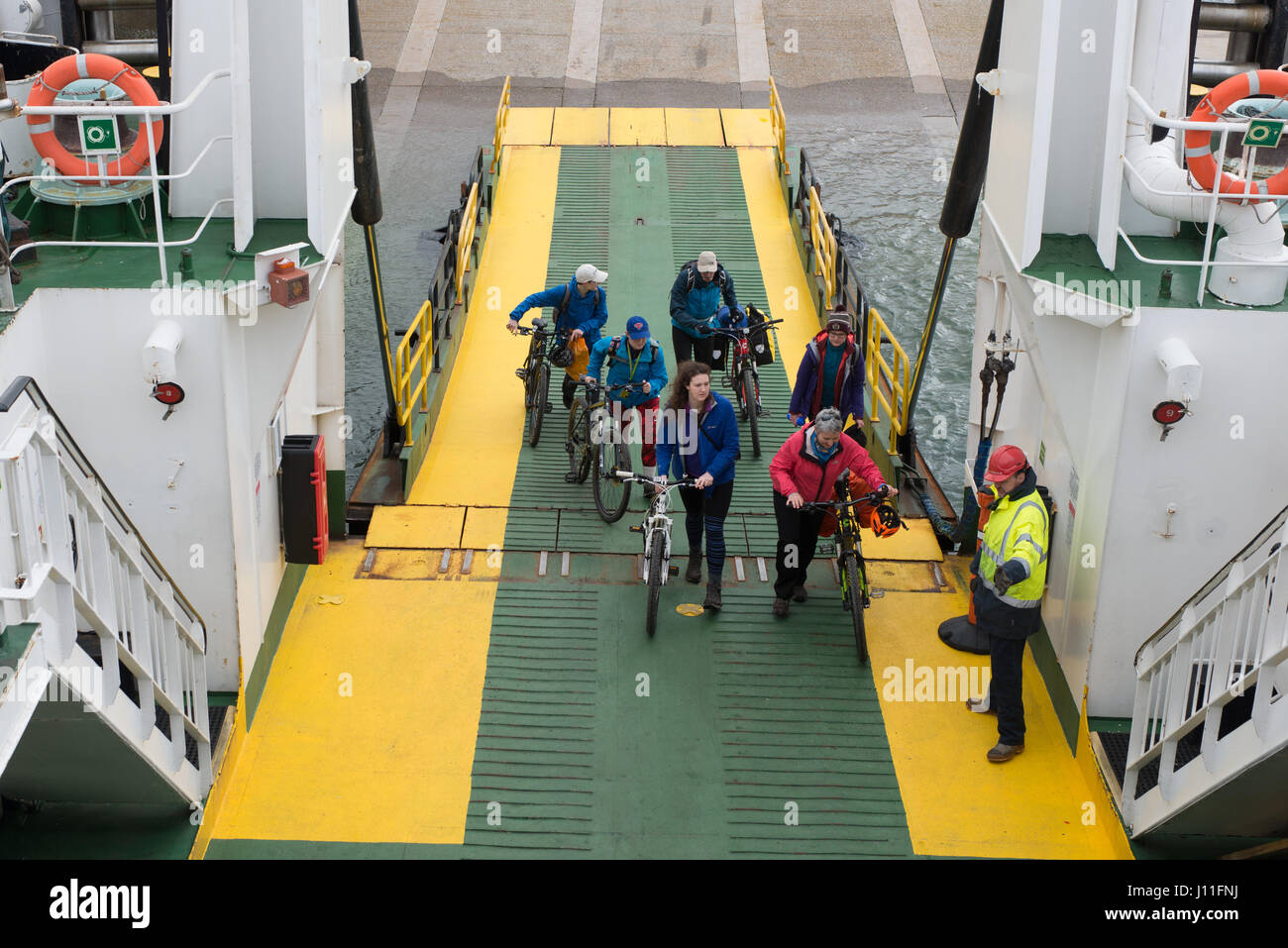Passengers boarding the Cal Mac Ferry Lochnevis on the island of Rum Inner Hebrides,  Scotland - Stock Image