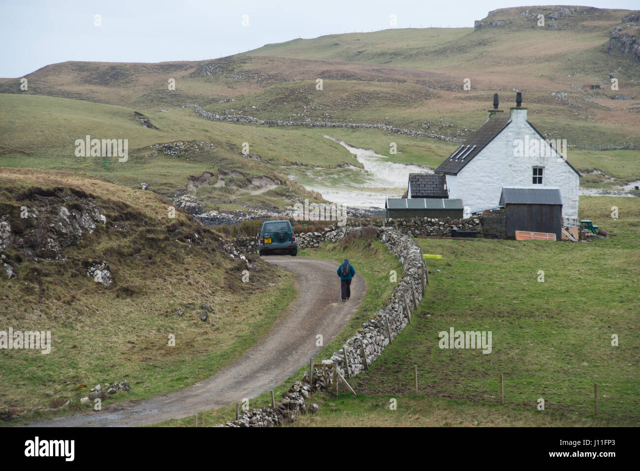 Isolated farm house on the island of Canna in the Inner Hebrides, Scotland. - Stock Image