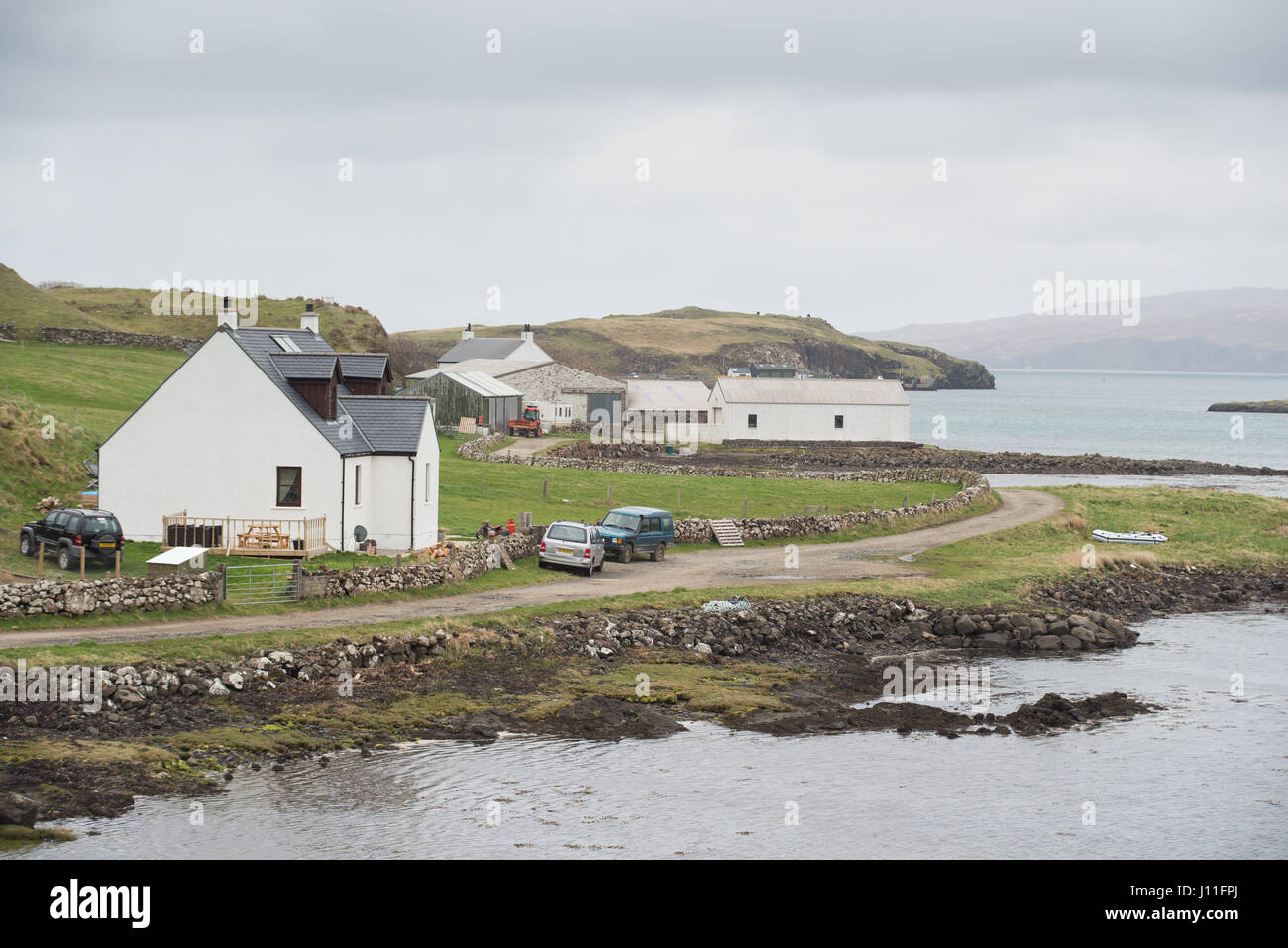 House and farm buildings on the Island of Canna Inner Hebrides Scotland - Stock Image